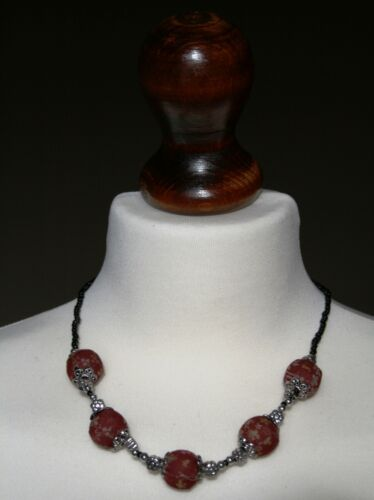 Floral fabric and silver bead cord necklace.