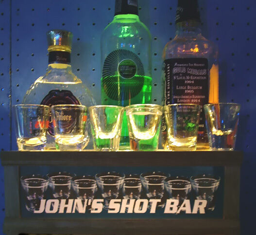 SOLID OAK shot glass display with LIGHTED TOP AND BUILT IN PERSONALIZED BAR SIGN
