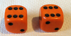 PAIR-OF-ORANGE-BLACK-SPOTS-DICE-DUST-VALVE-CAPS-VW-BMX