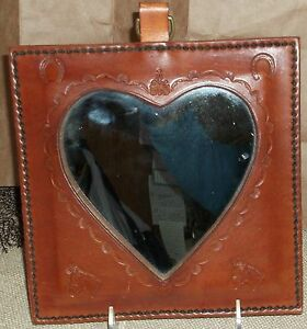 Vintage-Leather-Mirror-Heart-Shape-with-Horse-Motif-around-Mirror-gentle-use