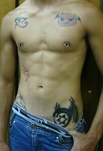 Shirtless male hunk tattoos nipple rings bare chest torso for Men nipple tattoo