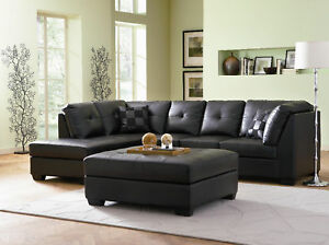 sleek button tufted black leather sofa chaise sectional living room