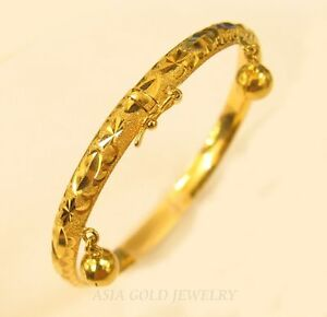 18K-gold-kids-bangle-with-charm-and-safety-lock