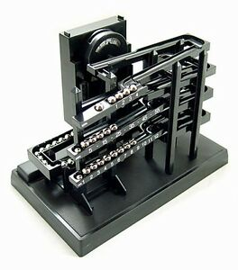 Time-Machine-Kinetic-Chrome-Rolling-Ball-Tabletop-Clock