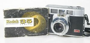 KODAK-AUTOMATIC-35-CAMERA-WITH-MANUAL-UNTESTED-SOLD-AS-IS