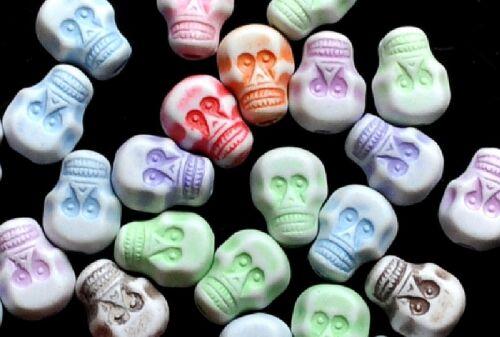 100pcs plastic skull beads choice of colors 9x7mm