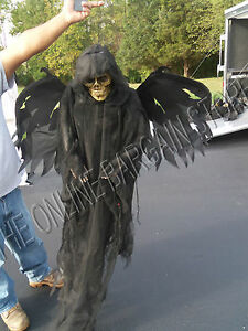 Grandinroad halloween creepy flying animated light up for Animated flying reaper decoration