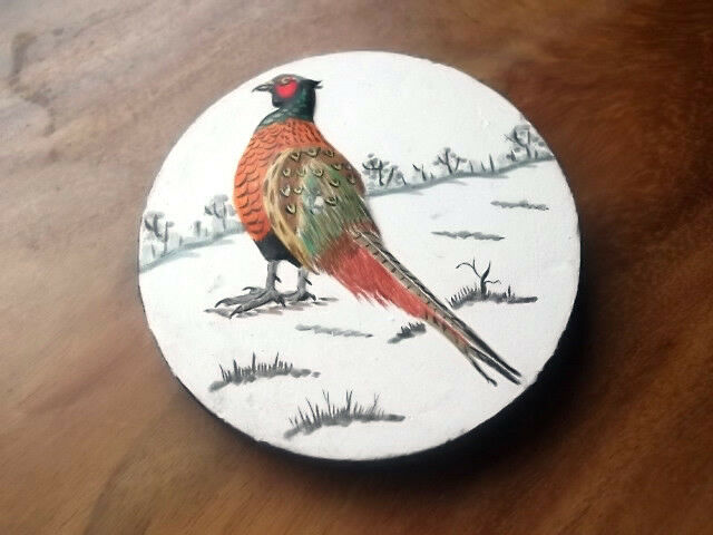 SMALL ROUND PLAQUE WITH A PHEASANT ON A SNOWY LANDSCAPE