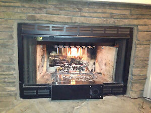 Stainless wood fireplace heat exchanger grate recovery for Fireplace heater system