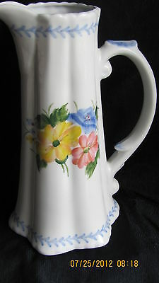 THIN UNSIGNED WHITE & BLUE TRIMMED FLORAL DESIGNED 8 INCH SMALL MOUTH PITCHER