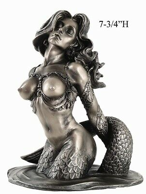 Sirens of the Sea Lure of Nude Mermaid Statue Temptations of the Uncharted Water