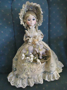 Bradley-Doll-with-Basket-of-Flowers-Beigh-Floral-Dress-and-Bonnet