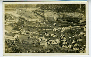 1910 RPPC Postcard showing a Town in Canada w/ Numerous Houses near a Dam