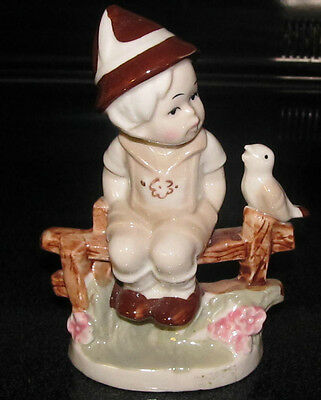 UCGC German Country Boy Figurine Sitting on a Fence Row Whistling with Song Bird