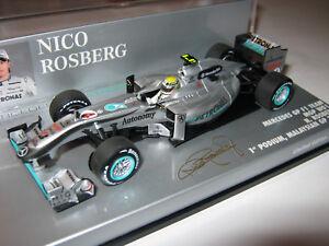 1-43-MERCEDES-GP-w01-N-Rosberg-1-podio-Malaysian-2010-41010104-Minichamps-NEW