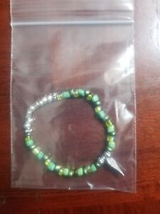 handmade-unique-womens-green-glass-bead-healing-wing-stretch-bracelet