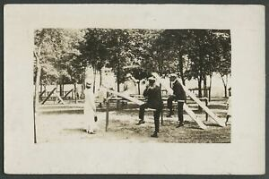 Troy-NY-c-1908-10-RPPC-Real-Photo-Postcard-GROUP-TEENS-YOUNG-ADULTS-ON-SEESAWS