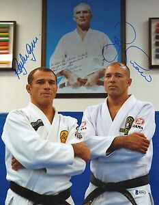 Royler royce gracie signed 11x14 photo bas beckett coa pride fc image is loading royler amp royce gracie signed 11x14 photo bas altavistaventures Images
