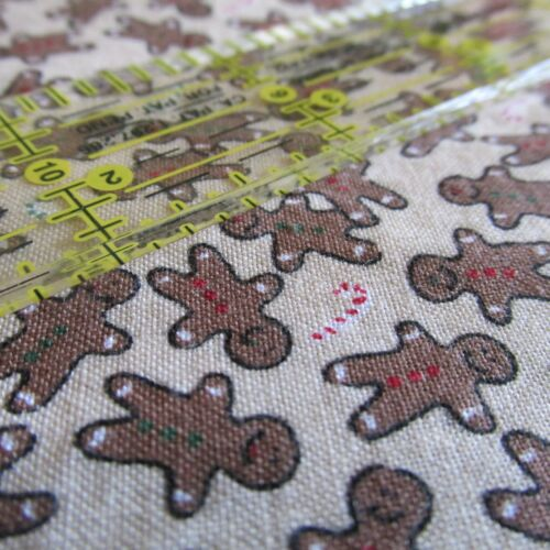 Christmas cotton fabric small scale gingerbread cookie man toss BTHY half yard