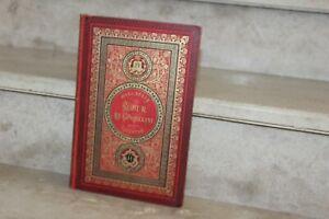 Jules VERNE. Robur le Conquérant. Hetzel 1886 cartonnage rouge aux initiales.
