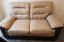 used beige and brown leather two seater sofa