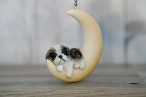 HANGING BLACK AND WHITE SHIH TZU PUPPY ASLEEP ON MOON ORNAMENT