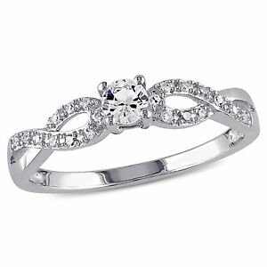 Silver Created Sapphire and 1/10 ct TDW Diamond Promise Ring H-I I2-I3