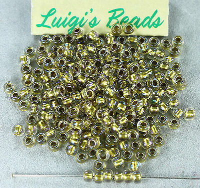 6/0 Round Toho E Glass Seed Beads #262-Crystal/Gold Lined 15g