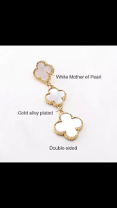 Triple hanging mother of pearl motif earrings.