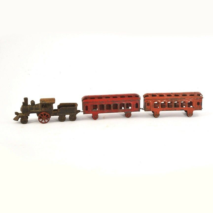 Vintage Stevens floor train set with engine, tender and two passenger cars