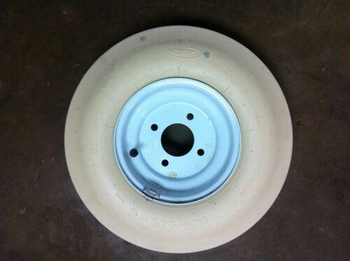 Universal Baseball// softball pitching machine tire mounted on a balanced wheel