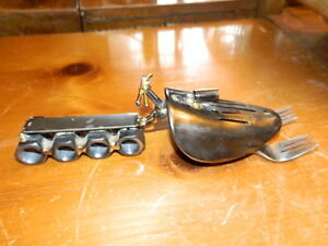 welded metal snowmobile figurine made of nuts forks shoe horn socket signed