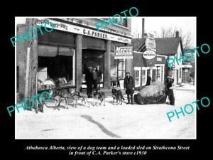 OLD-LARGE-HISTORIC-PHOTO-OF-ATHABASCA-ALBERTA-DOG-TEAM-AT-GENERAL-STORE-c1930