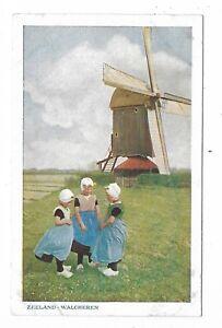 Zeeland-Walcheren-Three-Dutch-Children-Girls-standing-in-front-of-a-windmill