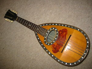 Old-MANDOLIN-with-a-nicely-flamed-back-needs-repair
