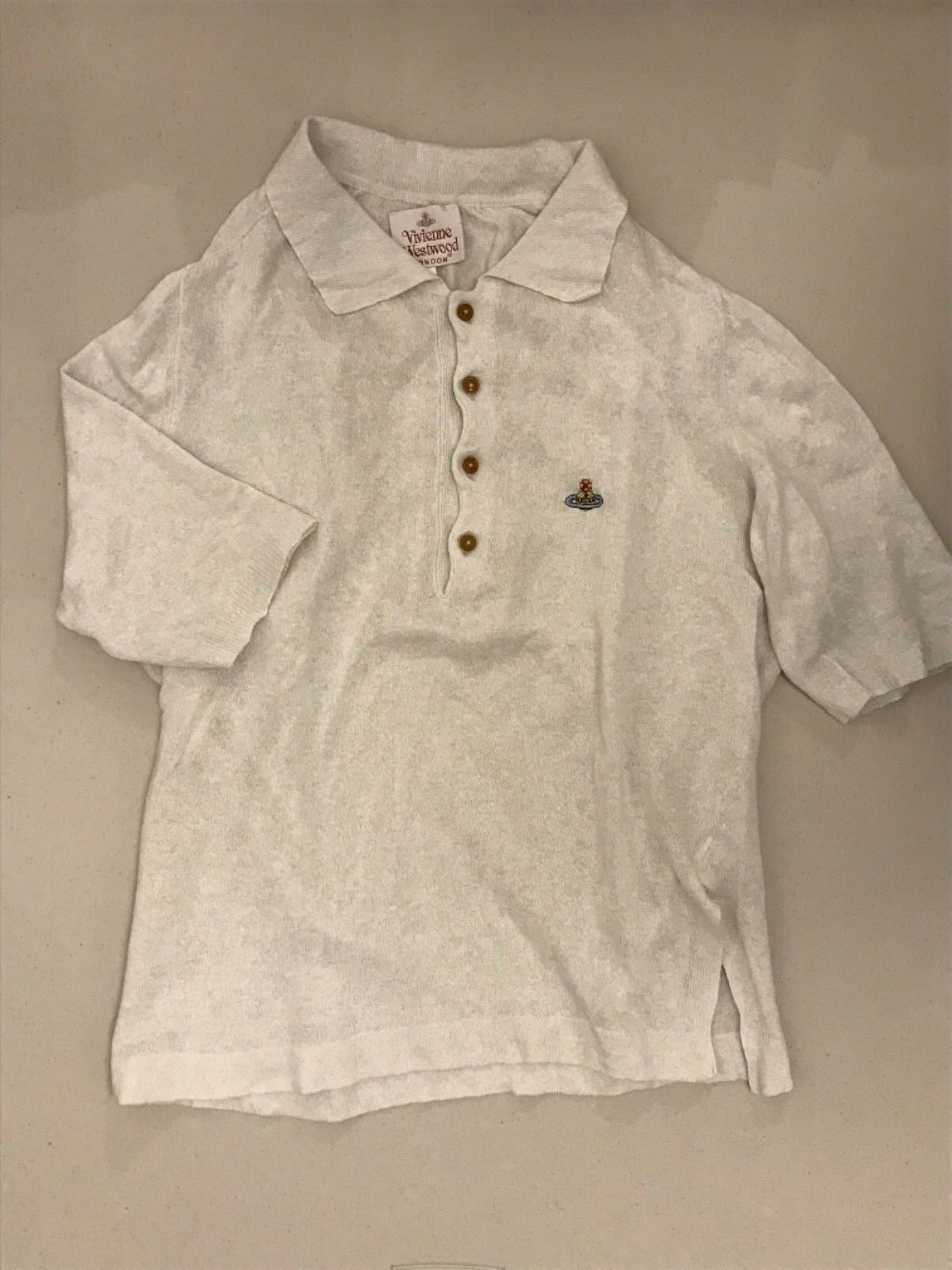 VIVIENNE WESTWOOD . Weiß linenT-shirt  isometric fit. Gold. Label