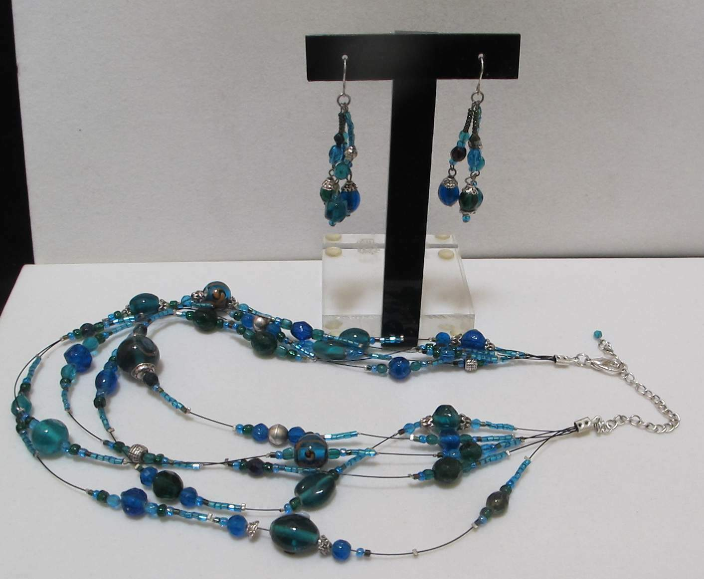 art.196 sleek cascaded design Necklace vintage 1950s Five Strands quality glass beads in vibrant turquoise color