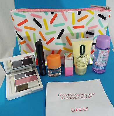 Clinique 7 Piece Compact, Bubblegum Pop Lip, Mascara, Lotion Bag Remover Happy