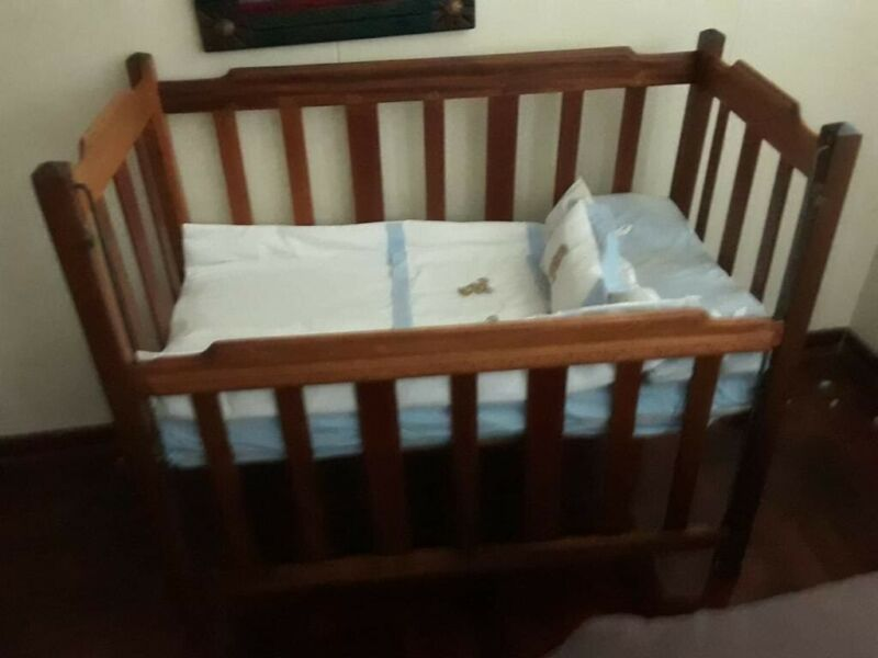 Cot with linen and mattress