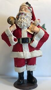 Santa-Claus-Christmas-smoking-a-Pipe-while-holding-a-bell-Paper-mache-Metal-base