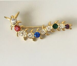 Vintage-caterpillar-brooch-in-gold-tone-metal-with-crystals