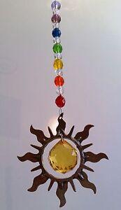 PEWTER-SUN-SHAPE-made-with-Swarovski-golden-crystal-sphere-rainbows