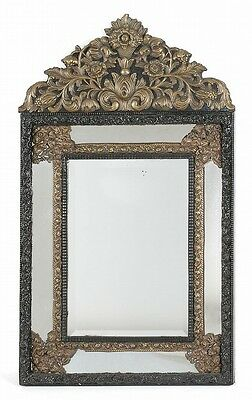 CONTINENTAL LOOKING GLASS Ebonized carved frame with arched crest and... Lot 304