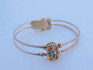Marquise Blue Topaz Spring Style Bracelet w/ 3 Diamonds - 10K Yellow Gold