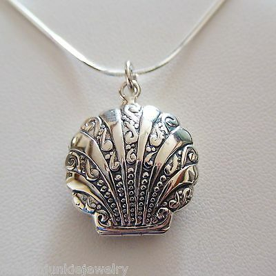 Beautiful oval Elephant locket necklace  holds 2 pics