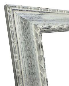 Cadre en bois blanc fond sombre art. 278.920 diverses mesures