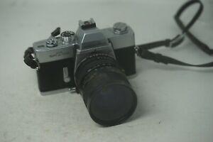Minolta-srt100x-35mm-Film-SLR-mit-Minolta-50mm-f2-Rokkor-Objektiv
