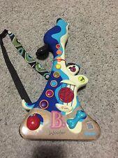 B. Woofer Dog Puppy Kids Musical Guitar Instrument Strum toy NEW NIB