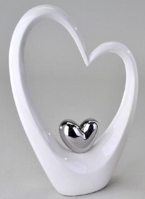 702968 FIGURINE SCULPTURE OBJET avec coeur en faïence blanc argent hauteur 25cm