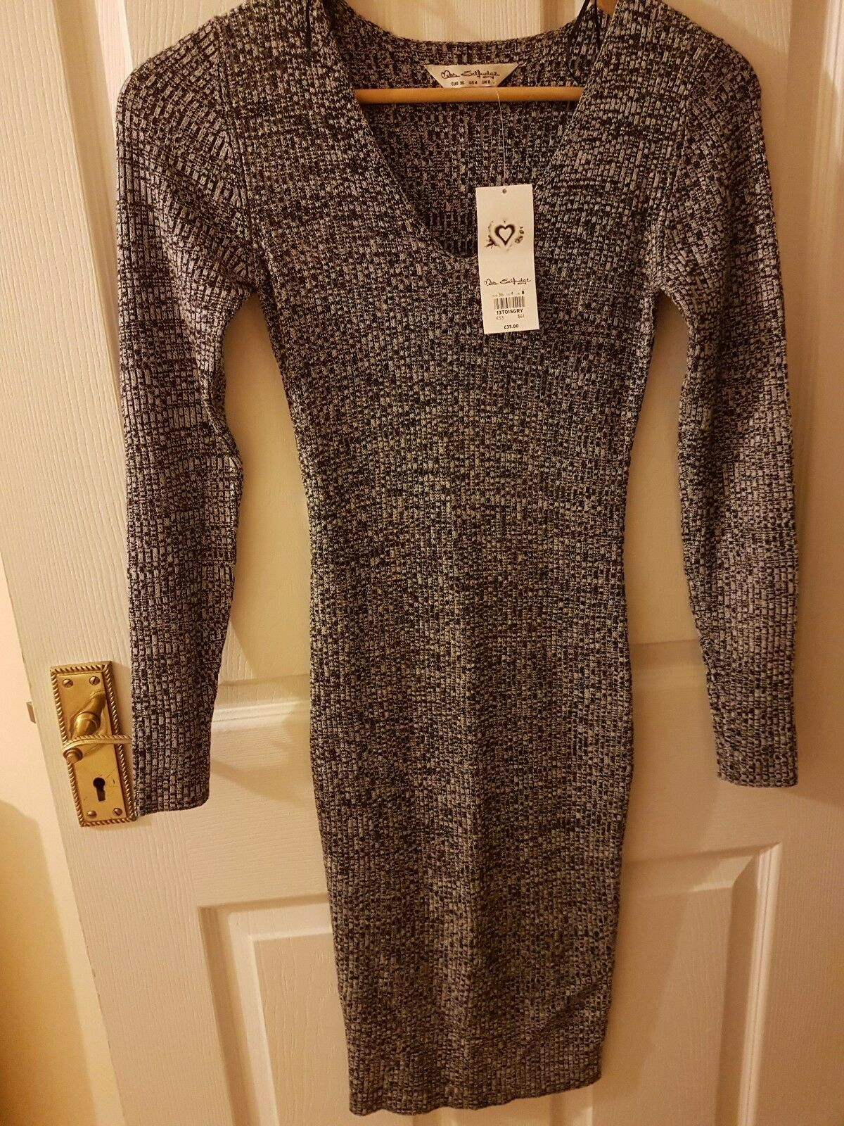 Miss selfridges size 8 bodycon with longsleeve. Very nice and warm.